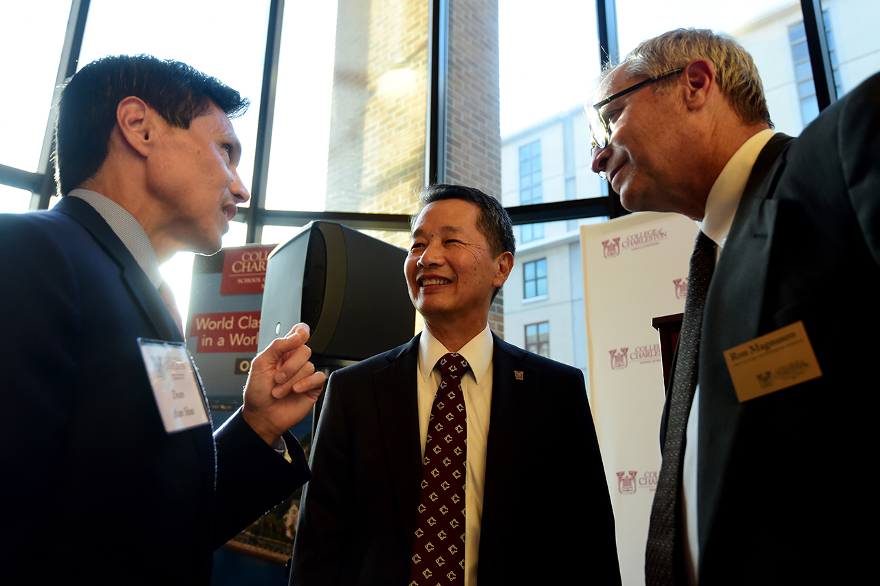 Dean Alan Shao and President Andrew T. Hsu talk with MBA director Ron Magnuson