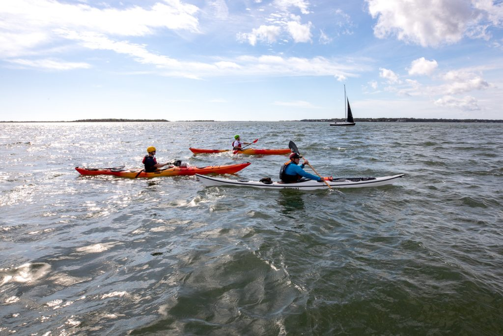 College of Charleston students participate in kayak rescue drills with the US Coast Guard.