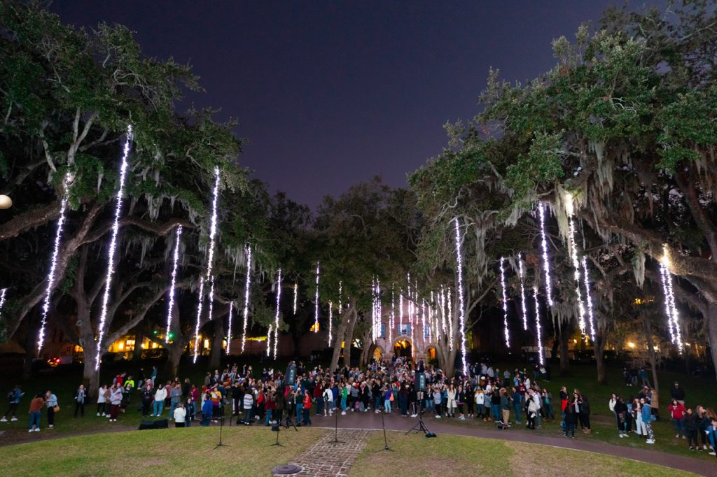cistern yard with strings of lights in the trees