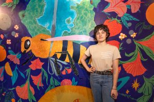 Cecilia McGuinn with her Mural