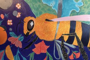 mural of a bee with planet earth
