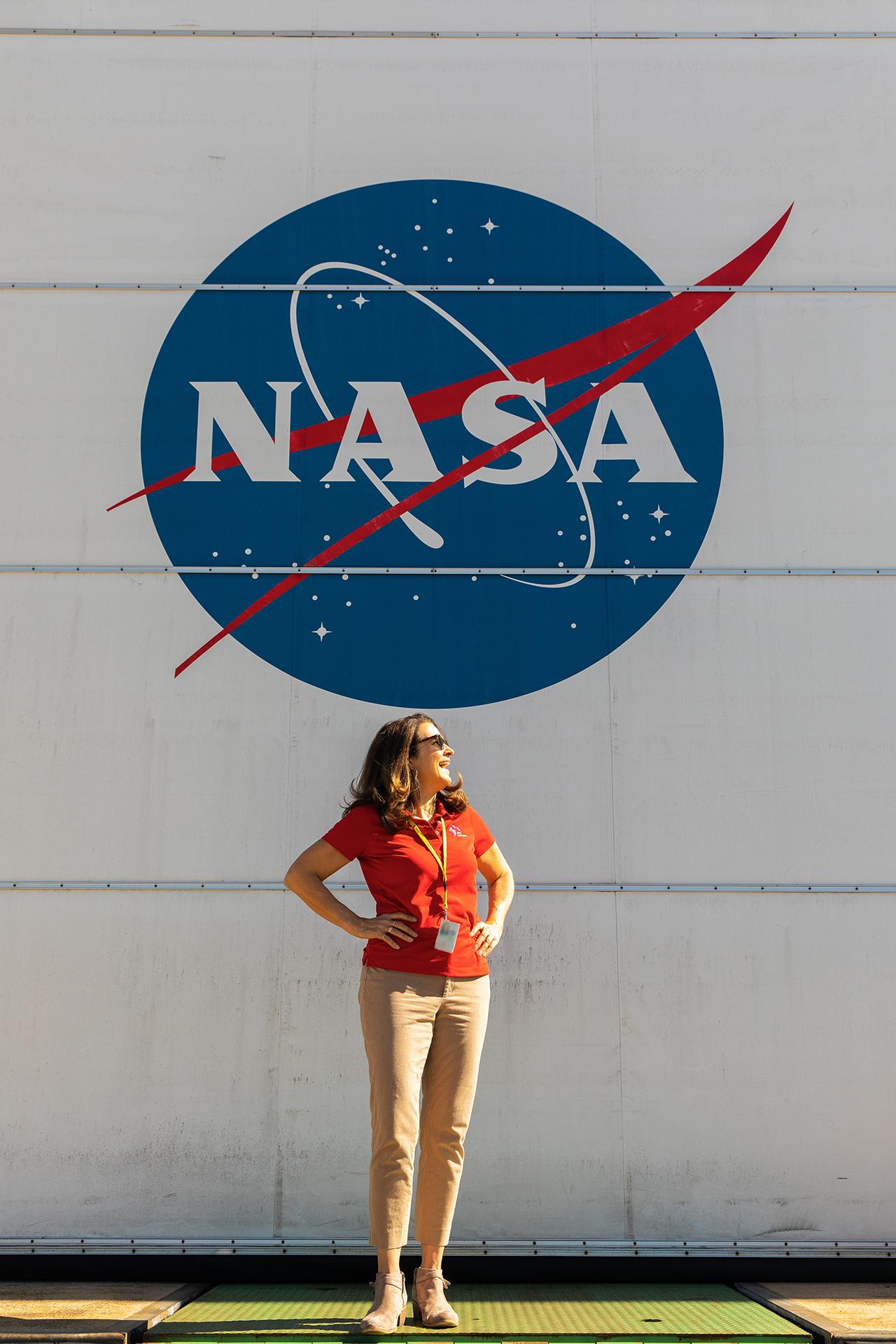 Dorlisa Hommel in front of a NASA sign