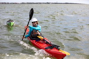 Ashley Brown conducting a kayak drill with the Coast Guard
