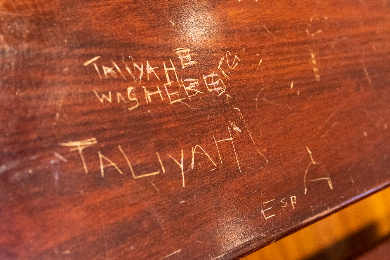 Names scratched into the old desk in the classroom at the Avery Research Center.