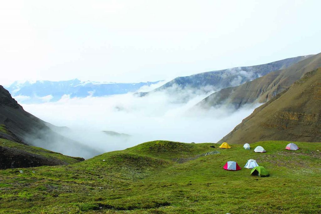 The campsite overlooks Triassic and Jurassic sedimentary rocks (hidden by fog).