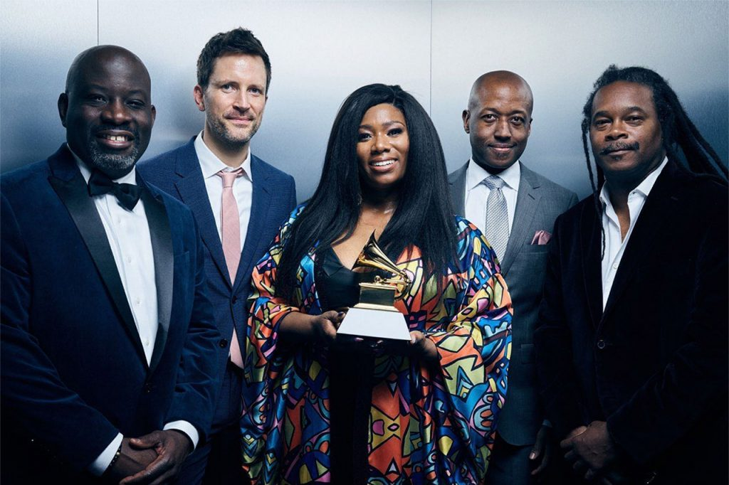 members of the band ranky tanky hold their grammy award