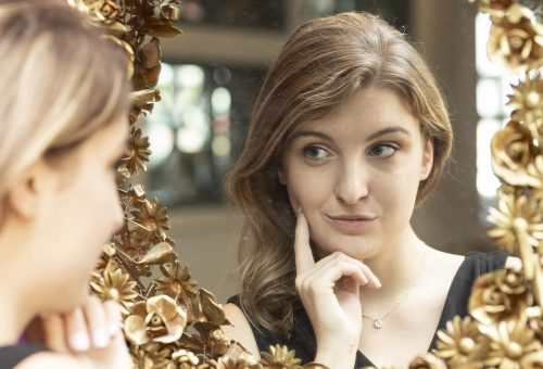Student Focuses on Selfie-Reflection