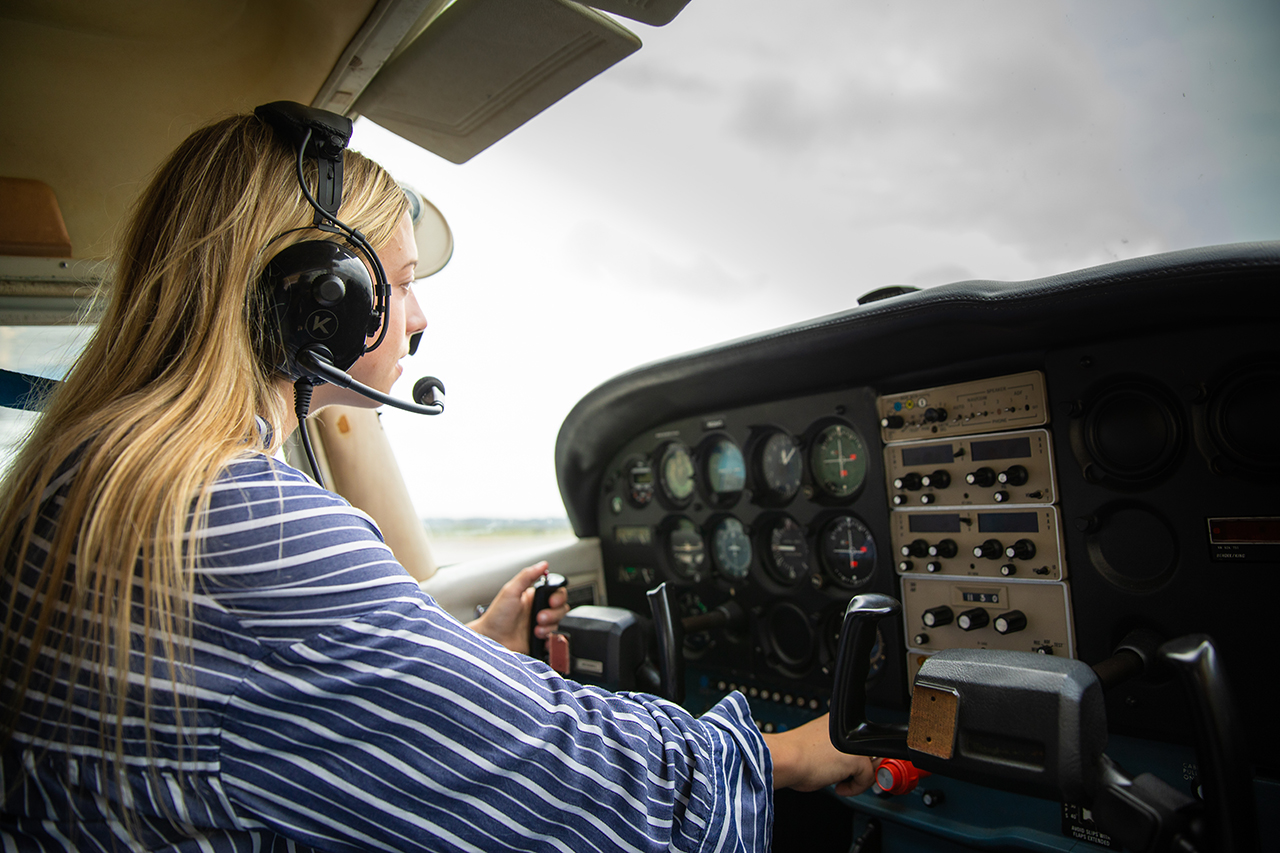 Samantha Bledsoe in the cockpit of a plane