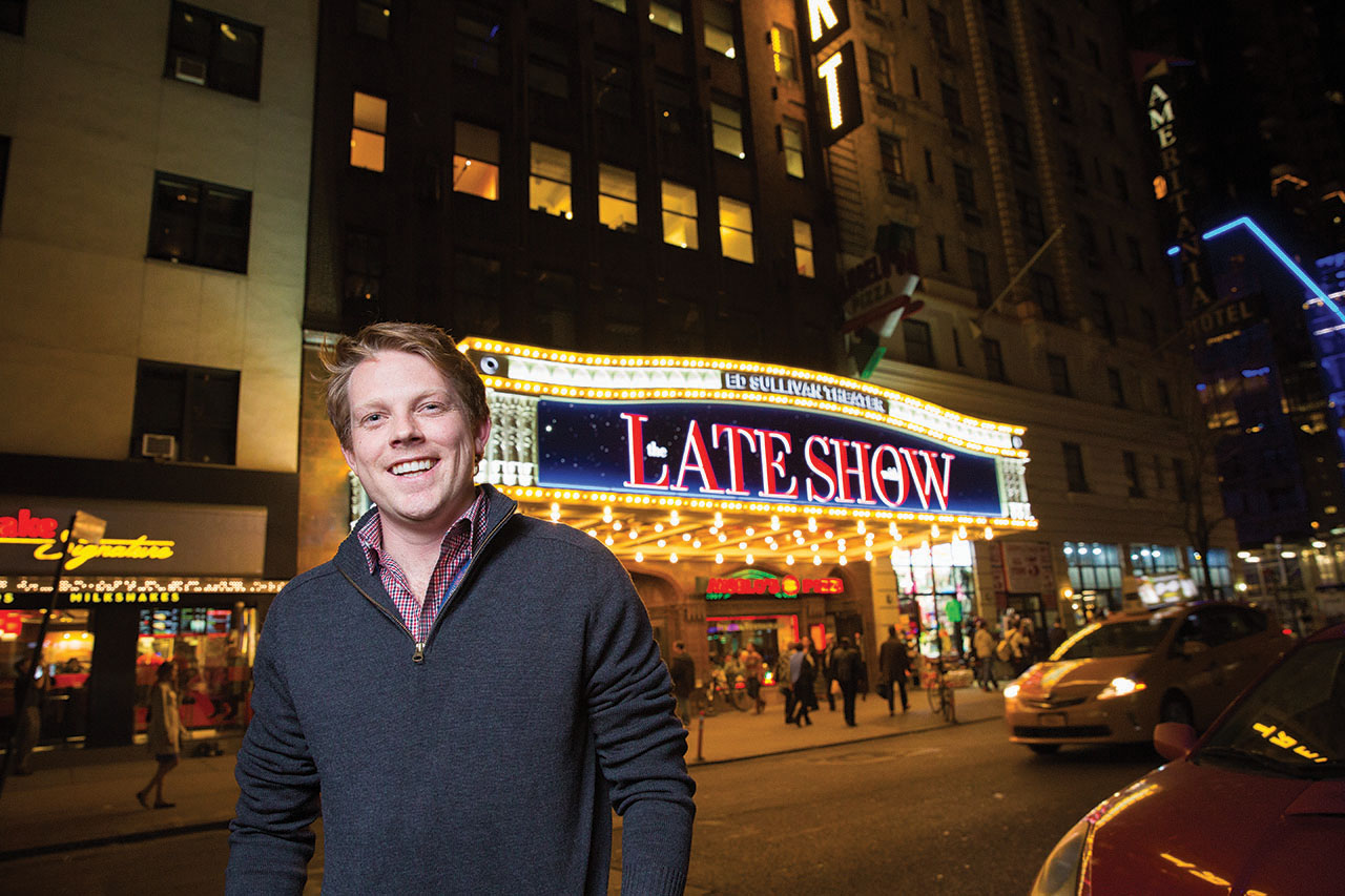 John Williams stands in front of the Late Show sign