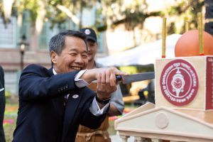 President Hsu cuts the 250th Anniversary cake during the celebration in Cistern Yard.