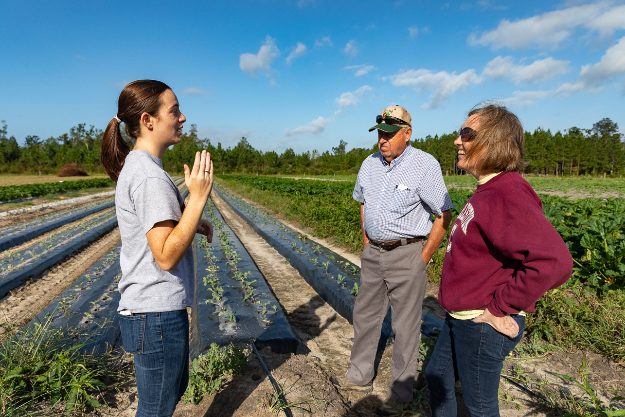 CofC student Adelaide Bates talks with owner of Hickory Bluff Berry Farms Walter Earley and his daughter CofC Alum Karen Parker in one of the farm's fields.