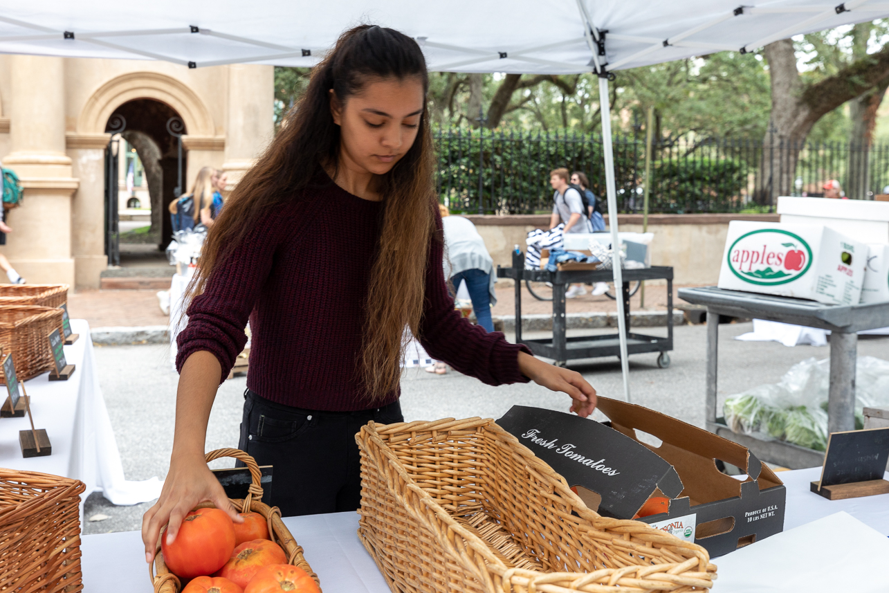 Aramark/CofC staff lay out the products for the farmer's market.