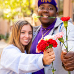 Students at CofC celebrate Valentines day with flower.