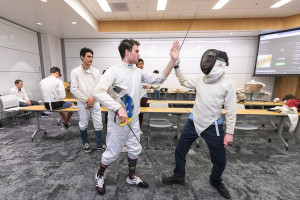 students in the fencing club at practice