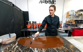 Bethany Moore Owner and Chocolatier of Cocoa Academic demonstrates her process for making Cocoa Academic chocolate.
