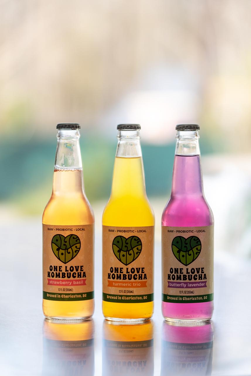 One Love Kombucha bottles on a table.