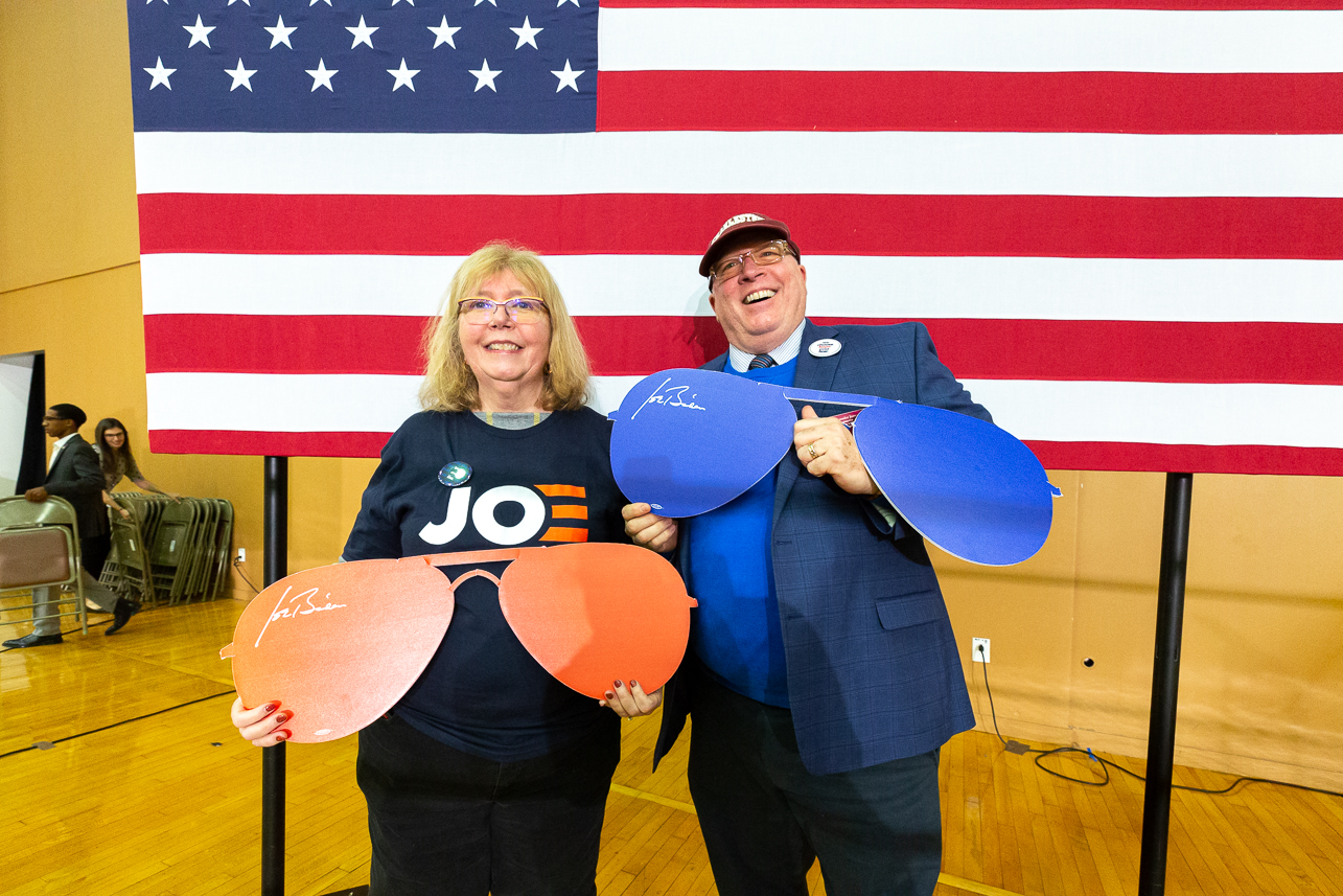 Ambassador Jim Melville and his wife pose in front of an American Flag after Presidential Candidate and former Vice President Joe Biden's visit to the College of Charleston for a Bully Pulpit Town Hall on Monday, February 24, 2020.