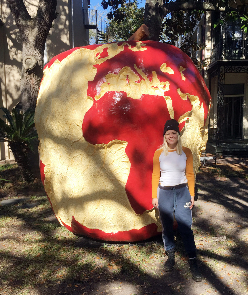 Asa Perryman poses with her apple sculpture
