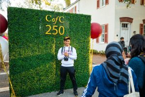 A student poses with a backdrop that says CofC 250 as part of the CofC Day celebration on Jan. 30, 2020.