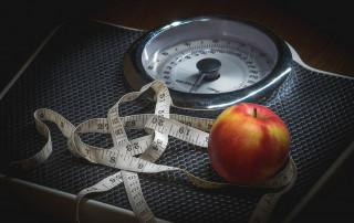 scale, measuring tape, apple