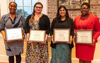 Phenomenal Women Award recipients Alumna Michelle Mapp, professor Sandra Slater, staff member Marla Robertson and student Cookie Desai