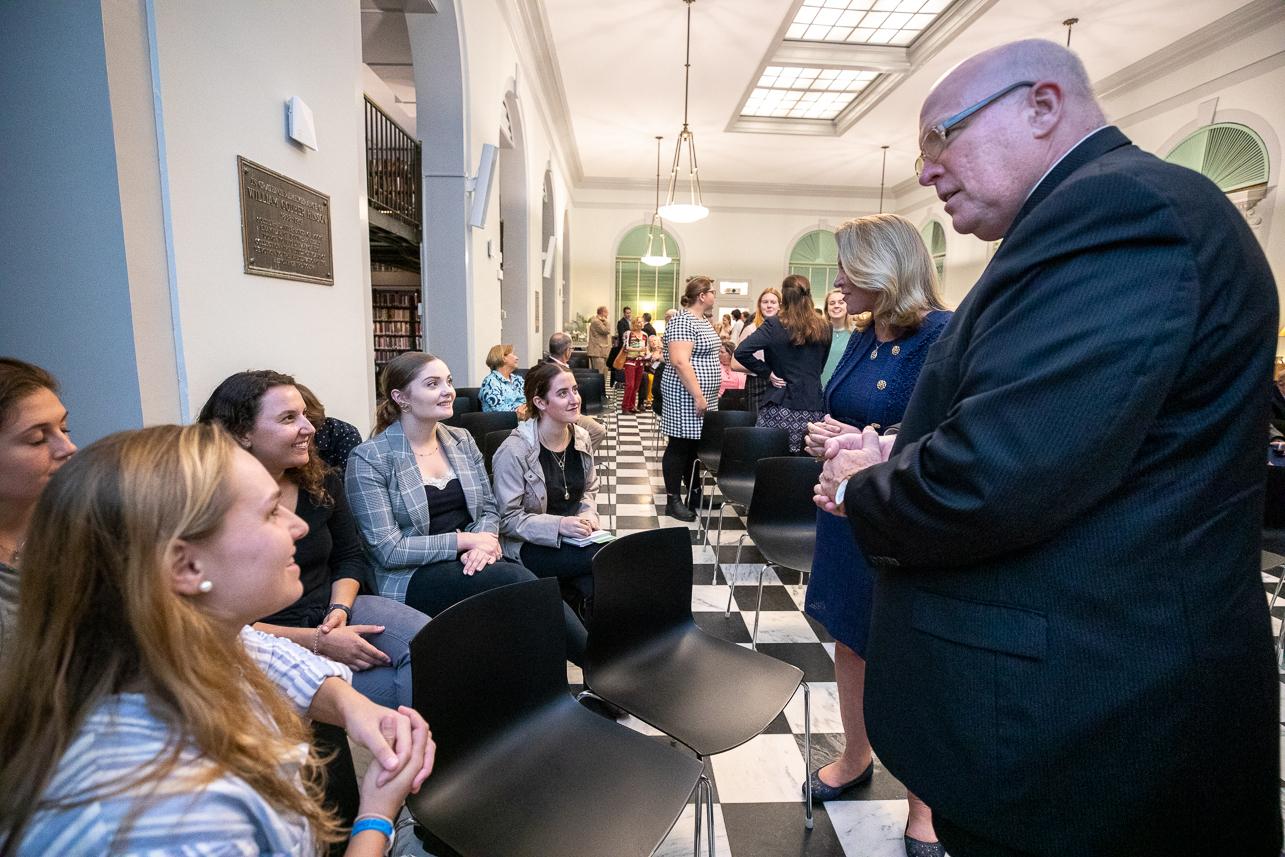 Ambassador Jim Melville introduces students from his Global Ambassador's class to former Secretary of the Navy Deborah James.