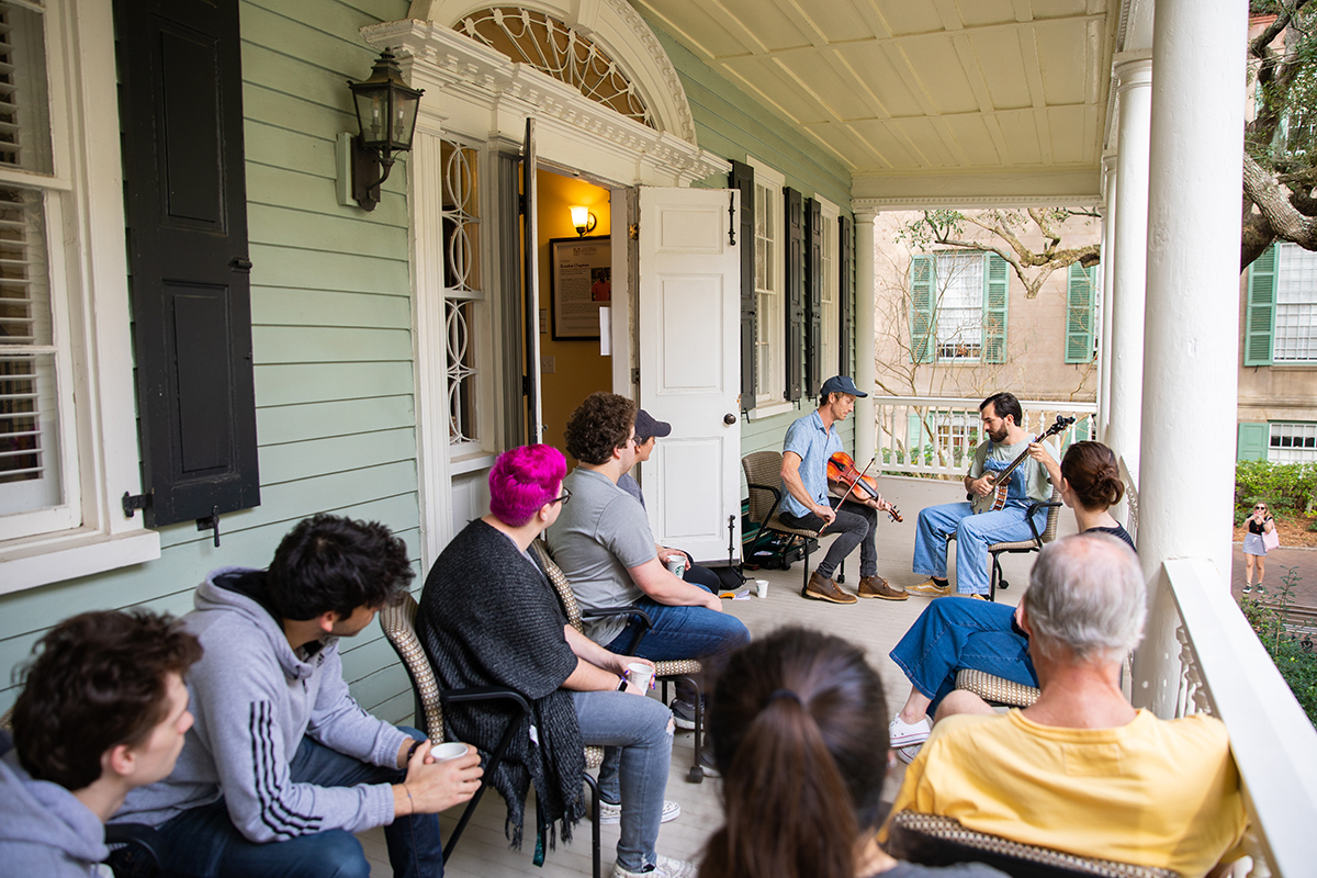 The Pluff Mud String Band performs to a small class on the College of Charleston campus.