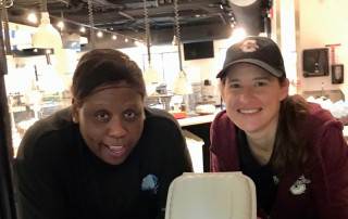 dining services employees pack to go meals