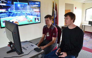 students in the esports club playing a video game