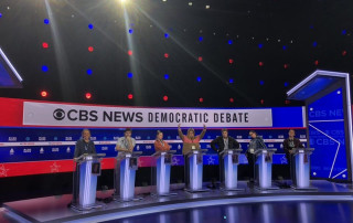 College of Charleston students serving as debate runners for the CBS News Democratic Debate stand-in for candidates on set at the Charleston Gaillard Center