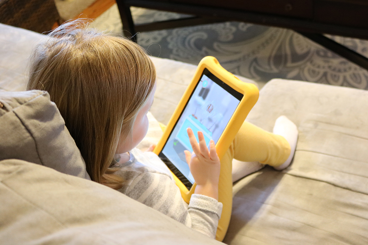 A child reads on an ipad