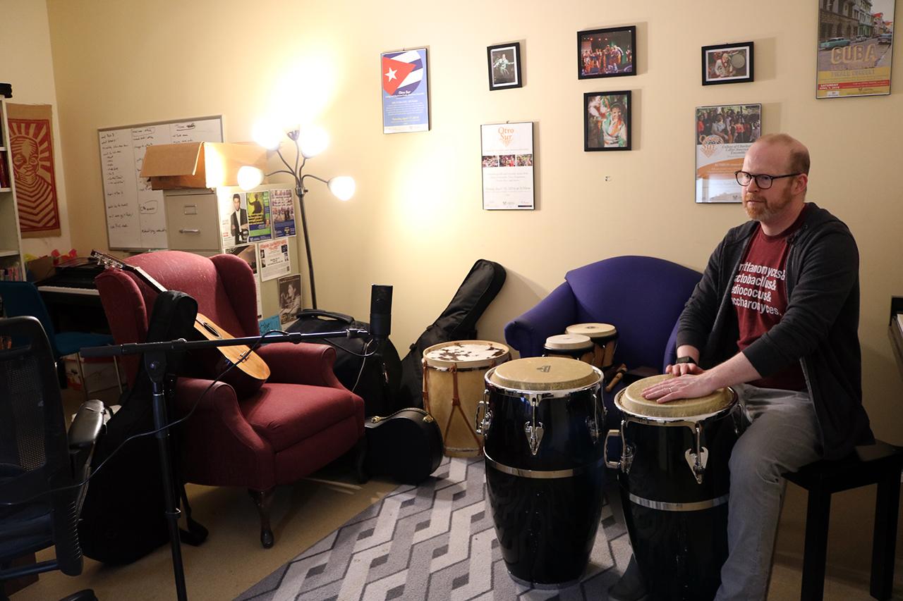 Michael O'brien plays the bongos