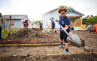 A student volunteers at habitat for humanity
