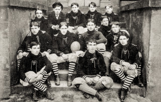 The 1897 College of Charleston Football Team on the steps of the Towell Library. Top row: Mazyck, O'Driscoll, Fogarty, Bull, O'Bryan. Middle Row: Marshall, Randolph, Chestnut, Holmes, Benet. Bottome ro: Sparkman, Boykin, Johnson