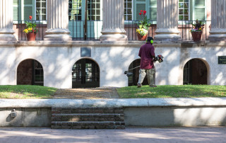 A Facilities Management groundskeeper trims the grass on the Cistern during the College's closure from the COVID-19 pandemic. April 8, 2020