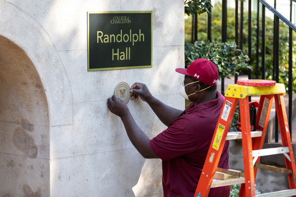Sam Holmes the Carpentry Shop Supervisor, places the 250th Plaque on Randolph Hall. April 8, 2020