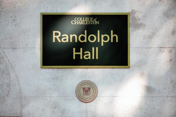 a medallion under the sign for Randolph Hall