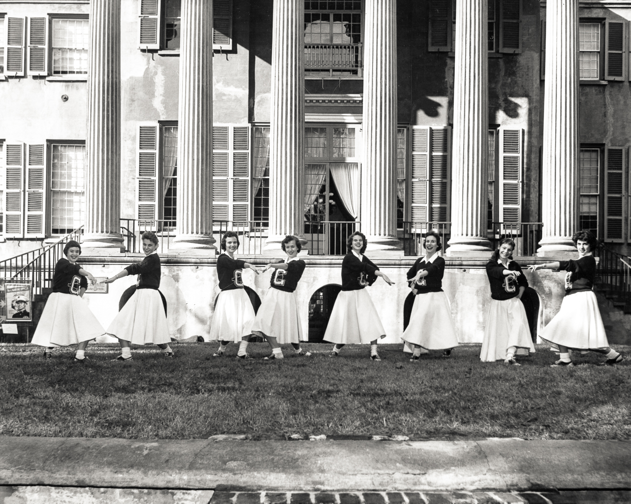 1958 Cheerleaders on the Cistern in front of Randolph Hall.