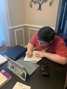 student Joe Brennan studies at home