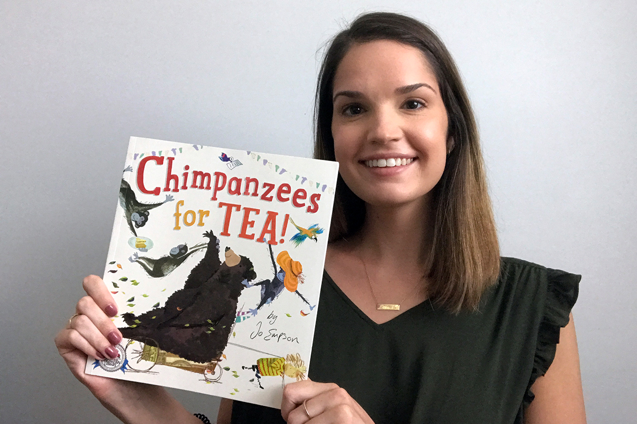 Lauren Croghan reads a book titled Champanzees for tea