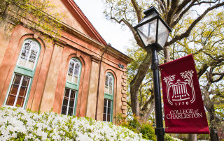 towell library with cofc flag and flowers