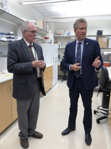 Blair Holladay with Peter Iwen in a lab