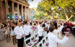 graduates throw diplomas in the air