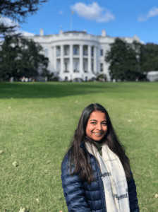 Zainab Dossaji stands in front of the White House