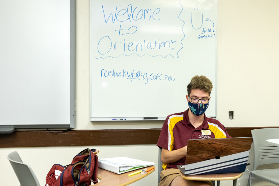 Student orientation leaders guide incoming students through orientation online. Due to the 2020 COVID-19 pandemic all campus activities were cancelled over the summer. Orientation students each had their own office to work in in Maybank Hall so that they could remove their masks when alone.