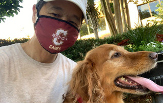 President Hsu with Hoosier the dog