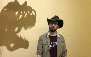 scott persons looks at the shadow of dinosaur