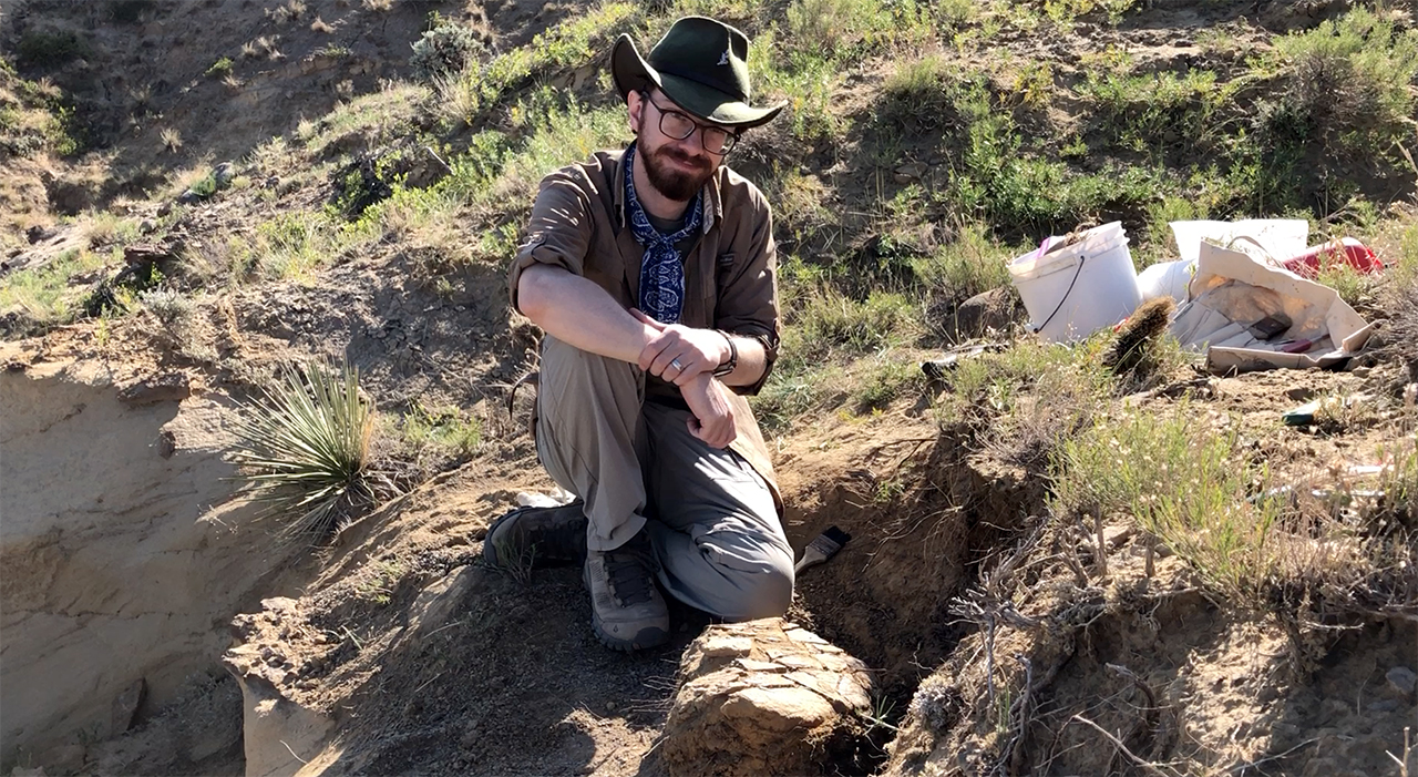 scott persons digs up a portion of a triceratops skull