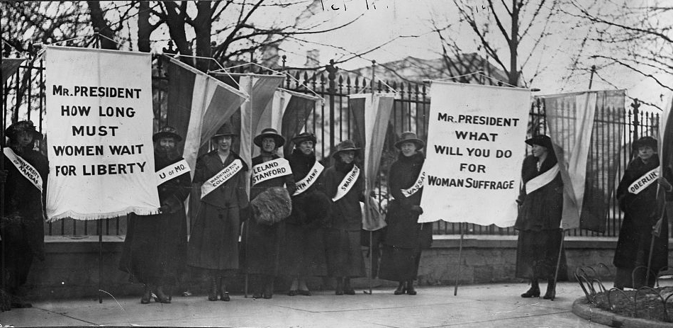 Women suffragists picketing in front of the White house.
