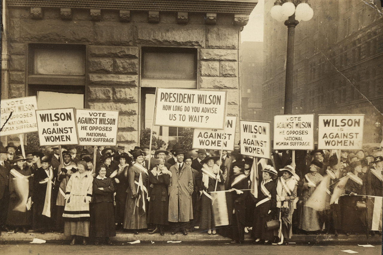 National Woman's Party members picket outside the International Amphitheater in Chicago, where Woodrow Wilson delivers a speech on Oct. 20, 1916.